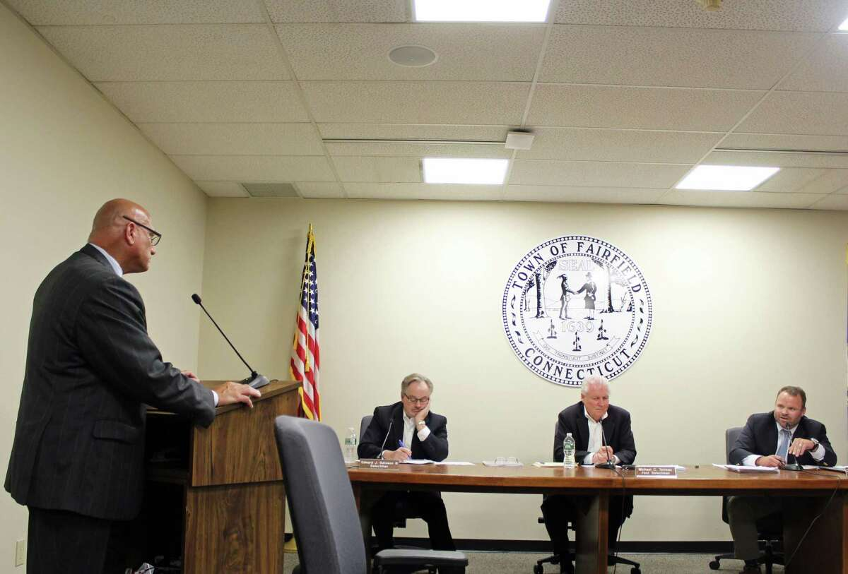 The Selectmen questioned HR Director Emmet Hibson about his knowledge of the criminal investigation.