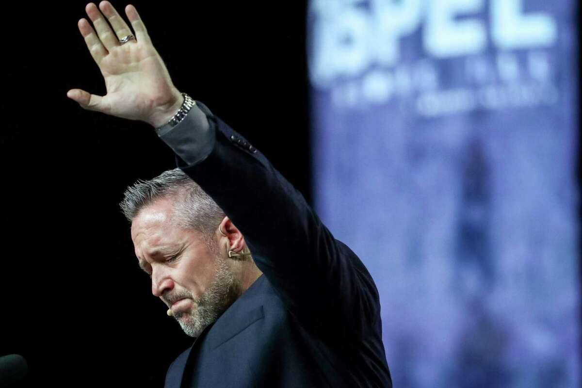 J. D. Greear, president of the Southern Baptist Convention, becomes emotional while talking about sexual abuse within the SBC on the second day of its annual meeting on Wednesday, June 12, 2019, in Birmingham.