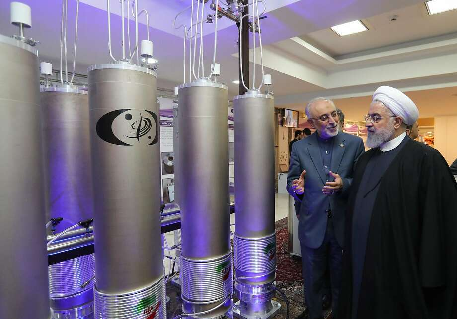 President Hassan Rouhani (right) listens to the leader of Iran's nuclear technology agency, Ali Akbar Salehi, earlier this year in Tehran. Photo: Iran Presidential Office