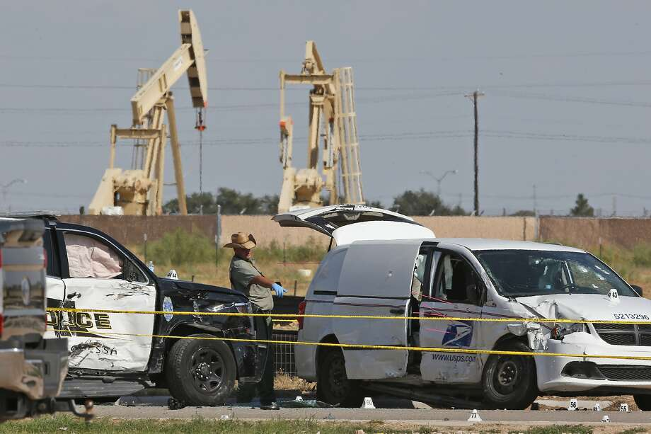 FILE - In this Sunday, Sept. 1, 2019, file photo, law enforcement officials process the crime scene from Saturday's shooting which ended with the shooter, Seth Ator, being shot dead by police in a stolen mail van, right, in Odessa, Texas. Within minutes of media outlets identifying the gunman who killed seven people in West Texas, a Twitter account was spreading false information linking the shooter to Democratic presidential candidate Beto O'Rourke. The speed of the misinformation again illustrates the eagerness of some to baselessly blame mass shootings on particular political ideologies. (AP Photo/Sue Ogrocki, File) Photo: Sue Ogrocki, Associated Press
