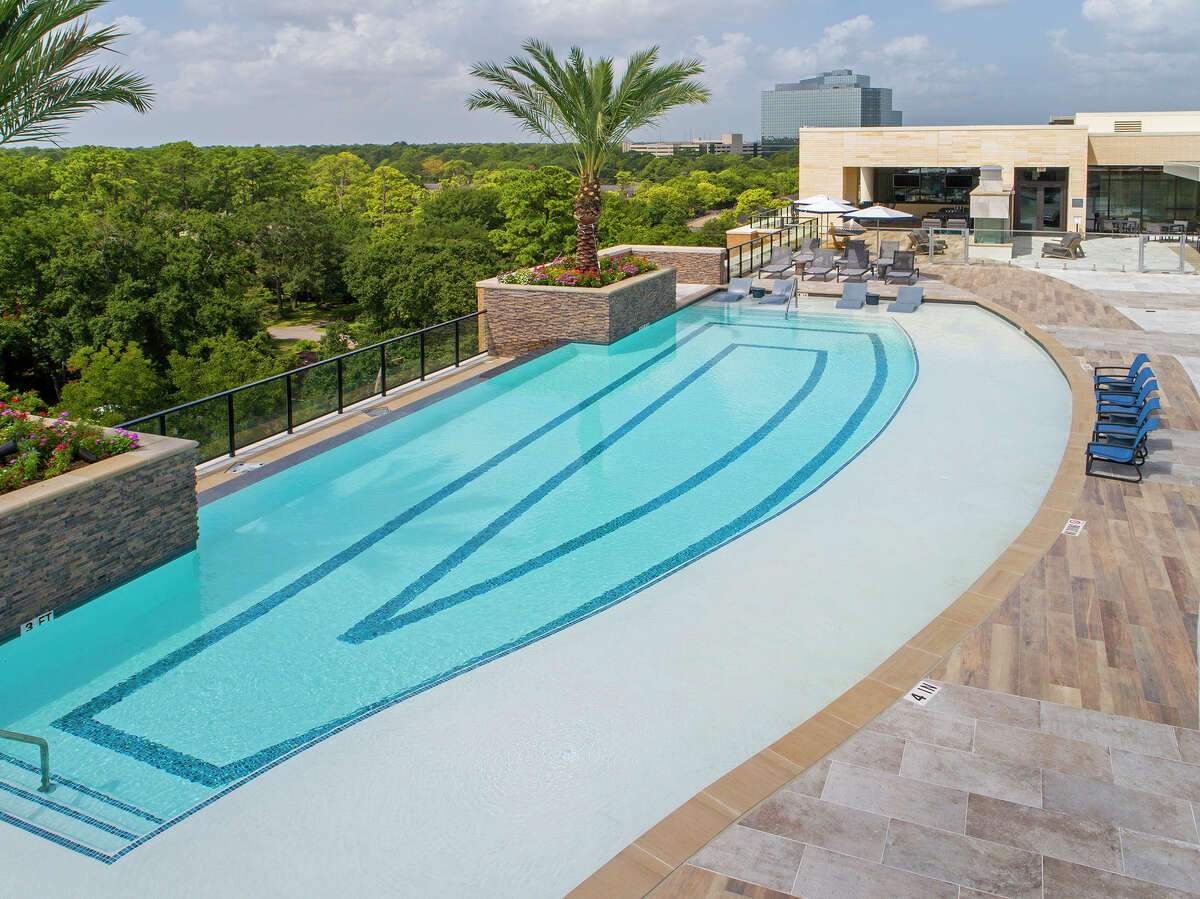 The rooftop infinity edge pool at The McAdams, a project of MetroNational and Slate Real Estate Partners at 12000 Barryknoll Lane.