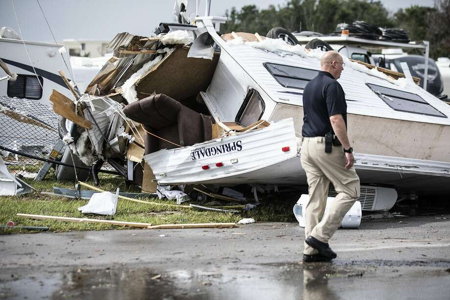Assistant Police Chief Bill Bailey observes damage after Emerald Isle, N.C. was hit by tornado generated by Hurricane Dorian. Photo: Julia Wall / Associated Press