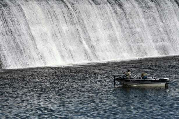 Fishermen try their luck on the Mohawk River bellow Lock 7 on Thursday, Sept. 5, 2019, in Niskayuna, N.Y. (Will Waldron/Times Union)