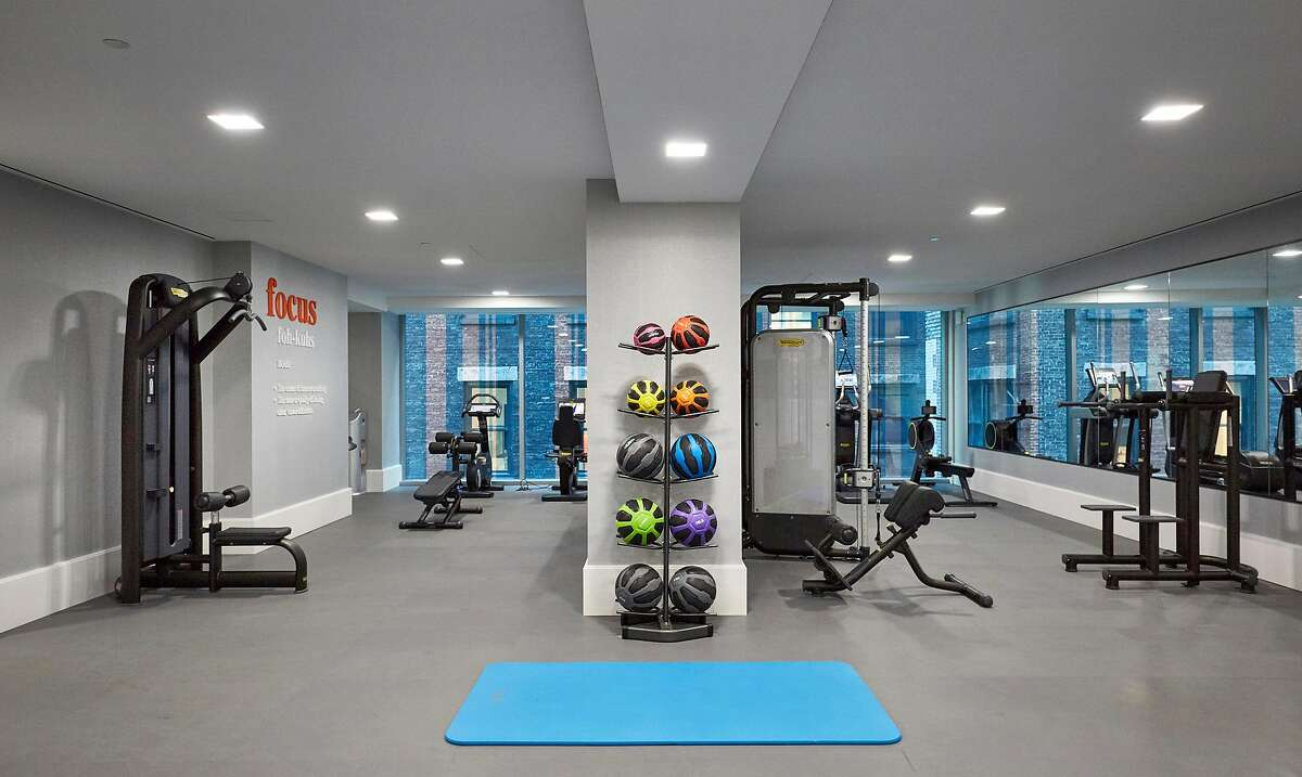 The gym at Madison Square Park Tower in Manhattan on Aug. 29, 2019. As sales of multimillion-dollar condos and apartments cool, developers are adding more luxuries to lure buyers. In luxury condos, a gym is one of the top five amenities, along with a doorman, an elevator, a laundry room and a roof deck. (John Muggenborg/The New York Times)
