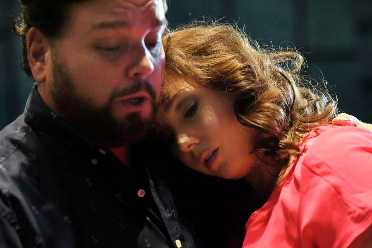 """Rafael Davila, from left, and Jennifer Rowley rehearse their roles as Cavaradossi and Tosca, respectively, in Opera San Antonio's staging of """"Tosca."""""""
