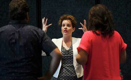 """E. Loren Meeker, shown giving notes to Jennifer Rowley and Rafael Davila as they worked on Opera San Antonio's staging of Puccini's """"Tosca"""" in September, has been named the company's general director."""