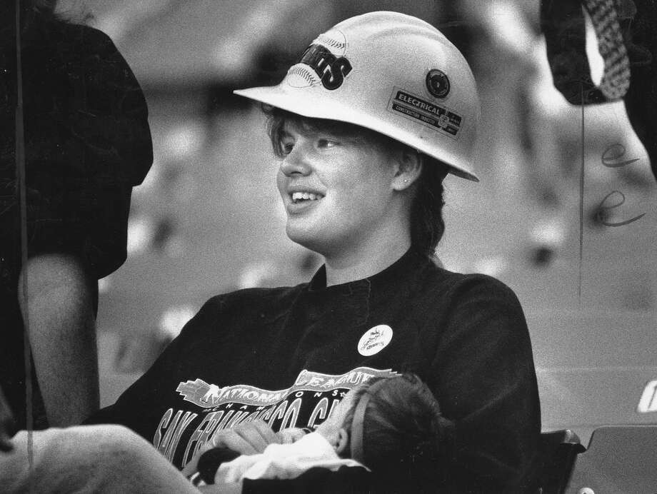 A Giants fan wears a hard hat to Game 3 of the World Series Oct. 27, 1989. The game was delayed 10 days because of the Loma Prieta earthquake. Photo: Michael Maloney / The Chronicle 1989