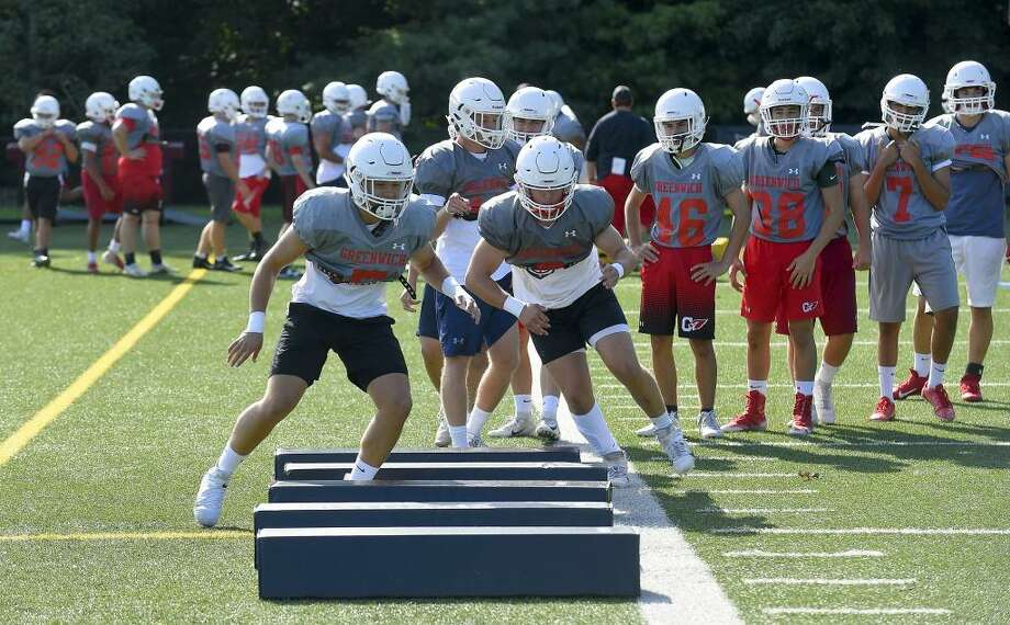 First day of conditioning/practice for Greenwich High School football, defending Class LL state champion, at the school in Greenwich on Aug. 26. Photo: Matthew Brown / Hearst Connecticut Media