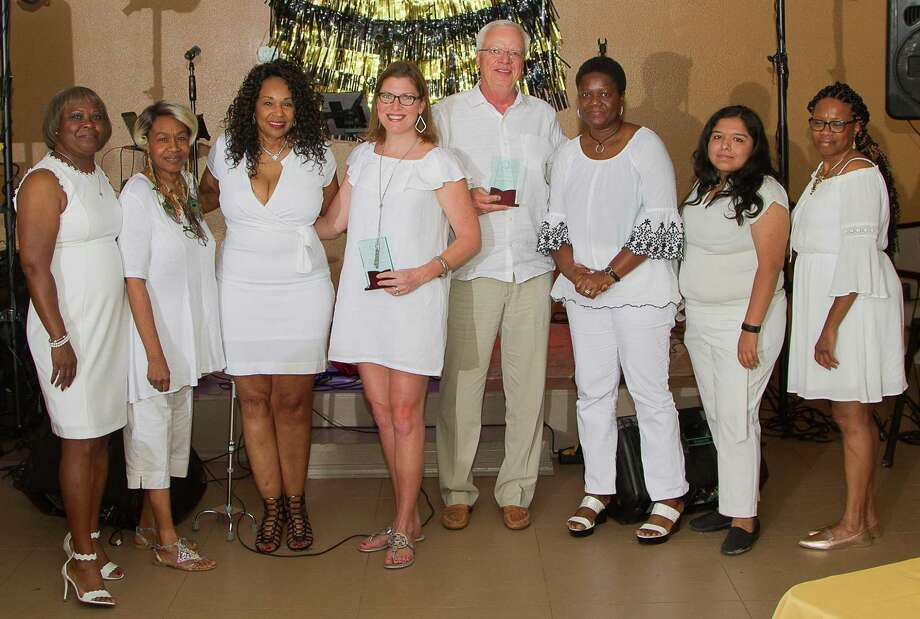 The Annual Dress White Linen Party hosted by Children's Books on Wheels (CBOW) took place on Aug. 31 at the Sleepy Hollow Multipurpose Building, 9845 Sleepy Hollow Road in Tamina. Pictured from left at the event are Constance Borders (Board Member), Wanda Woodworth (Board Member), Rita Wiltz (Executive Director CBOW), Natalie Goertz (honoree), Roger Goertz (honoree), Edna Asare (Board Member), Viridiana Vega (Board Member), Mary Butler (Board Member). Natalie and Roger Goertz were honored at the event for their service to the Children's Books on Wheels organization. Photo: Courtesy Photo