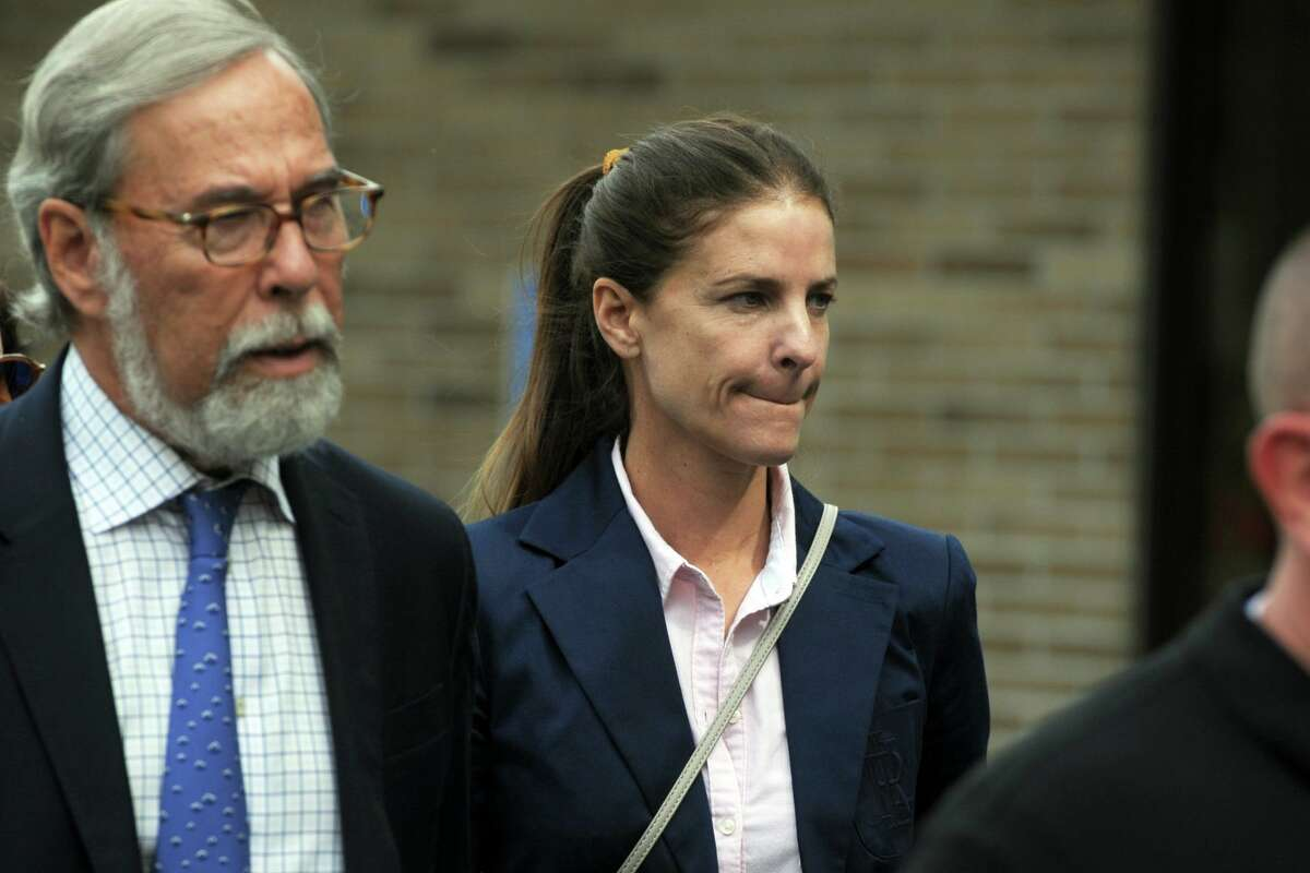 Michelle Troconis, with her attorney Andrew Bowman, leaves Connecticut State Police Troop G in Bridgeport, Conn. after turning herself in to face additional charges in the Jennifer Dulos case Sept. 5, 2019.