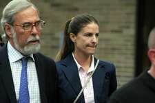 Michelle Troconis leaves Connecticut State Police Troop G in Bridgeport, Conn. after turning herself in to face a new tampering with evidence charge in the Jennifer Dulos case on Sept. 5, 2019.