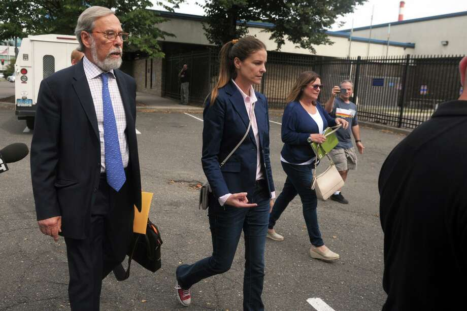 Michelle Troconis leaves Connecticut State Police Troop G in Bridgeport, Conn. after turning herself in to face additional charges in the Jennifer Dulos case Sept. 5, 2019. Troconis and Fotis Dulos, who was also arrested on Wednesday on additional charges, have both pleaded not guilty to hindering prosecution and tampering with evidence in connection with Jennifer Dulos' disappearance. Photo: Ned Gerard / Hearst Connecticut Media / Connecticut Post