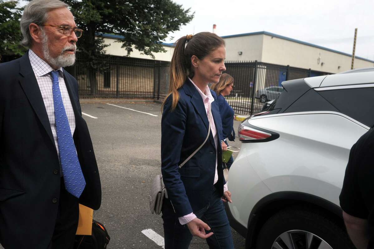 Michelle Troconis leaves Connecticut State Police Troop G in Bridgeport, Conn. after turning herself in to face additional charges in the Jennifer Dulos case Sept. 5, 2019. Troconis and Fotis Dulos, who was also arrested on Wednesday on additional charges, have both pleaded not guilty to hindering prosecution and tampering with evidence in connection with Jennifer Dulos' disappearance.