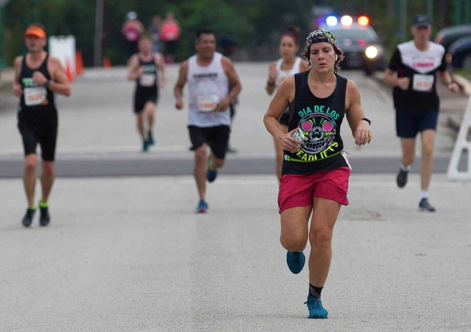 Runners take part in the annual Woodforest Charity Run, Saturday, Sept. 22, 2018, in downtown Conroe. This year's run is set for Saturday, Sept. 14, in downtown Conroe. Photo: Jason Fochtman, Houston Chronicle / Staff Photographer / © 2018 Houston Chronicle