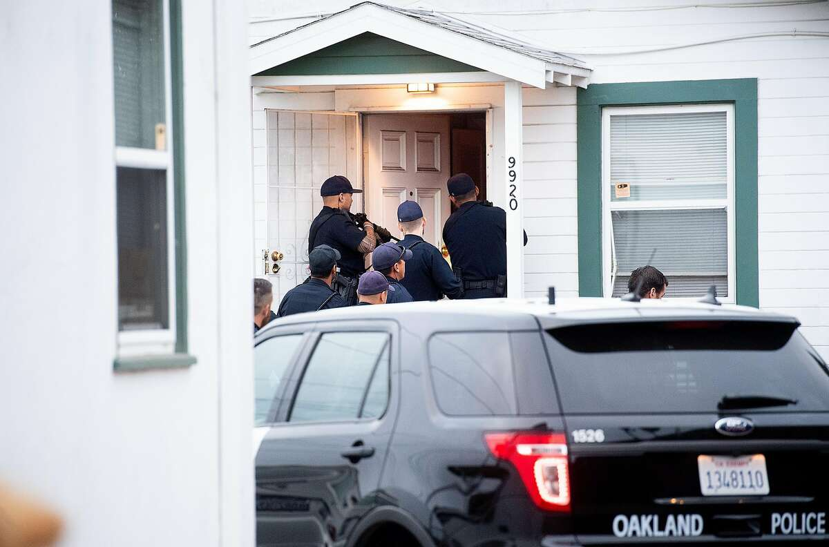 ** EMBARGOED TILL OAKLAND POLICE DEPARTMENT NOTIFIES SFC THAT THE OPERATION IS COMPLETE ** Police officers execute a search warrant at an Oakland, Calif., home on Thursday, Aug. 29, 2019. The raid was part of a multi-city, multi-agency operation targeting robbers that police say stole shipments of smart phones from delivery drivers.