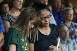 High School students Celeste Lujan, left, and Yasmin Natera mourn their friend Leila Hernandez, one of the victims of the Saturday shooting in Odessa, at a memorial service Sunday, Sept. 1, 2019, in Odessa, Texas.