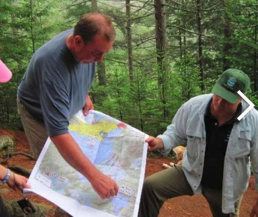 Michael Carr, formerly of The Nature Conservancy points, out some features of the state's Adirondack Park expansion.