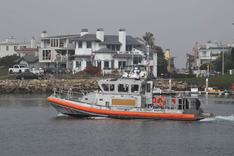 FILE - A Coast Guard crew leaves the US Coast Guard Station Channel Islands on Sept. 2, 2019. The U.S. Coast Guard rescued three people Saturday from a fishing boat that capsized about 30 miles northwest of Bodega Bay, but have suspended their search for a fourth man. Photo: MARK RALSTON/AFP/Getty Images