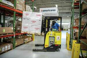 Workers prepare shipments of supplies to areas affected by Hurricane Dorian at Stamford's Americares warehouse. On Thursday, team members from the health-focused relief and development organization spent their first full day in the Bahamas, which was hit by Dorian, now a Category 5 hurricane. Americares also has team members on standby to provide relief in Florida and the southern states impacted by the storm.