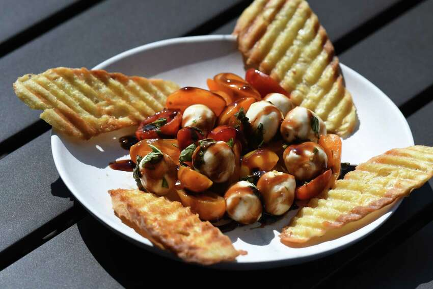 Caprese; fresh mozzarella, basil, plumb tomatoes and crostini topped with a balsamic glaze reduction from Shaker & Vine on Thursday, Aug. 29, 2019, at Mohawk Harbor in Schenectady, N.Y. (Will Waldron/Times Union)