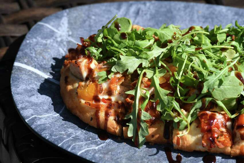 Chicken bruschetta pizza; diced chicken, mozzarella, arugula and house-made bruschetta with a balsamic glaze from Shaker & Vine on Thursday, Aug. 29, 2019, at Mohawk Harbor in Schenectady, N.Y. (Will Waldron/Times Union)