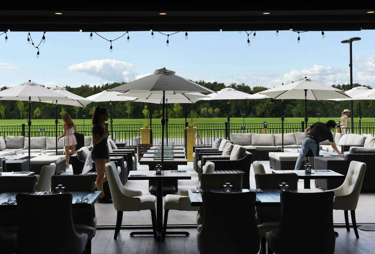 View looking out of the dining room to the outdoor seating at Shaker & Vine on Thursday, Aug. 29, 2019, at Mohawk Harbor in Schenectady, N.Y. (Will Waldron/Times Union)