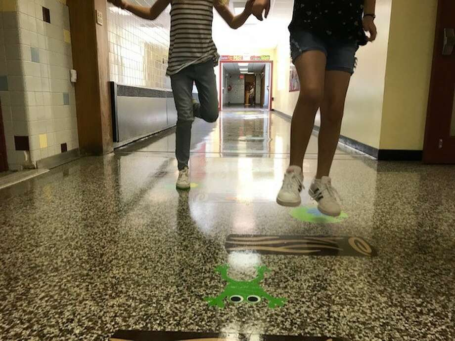 Students at Charlton Heights Elementary School in Ballston Lake demonstrate how to use the school's new sensory pathway. Photo: (Rachel Silberstein/Times Union)