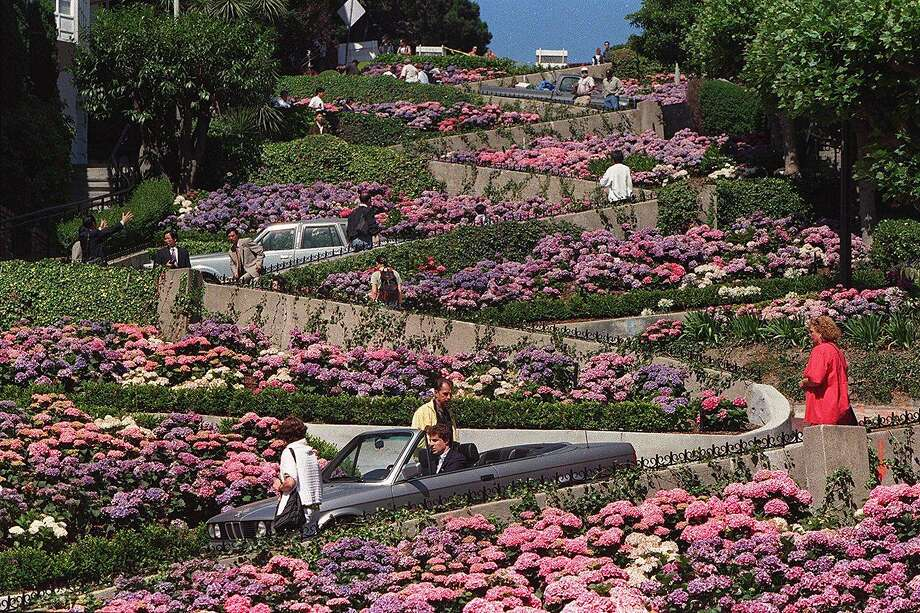 The Legislature passed a bill Thursday that would let San Francisco experiment with a toll and reservation system on the crooked portion of Lombard Street, shown here. Photo: Lea Suzuki/The Chronicle