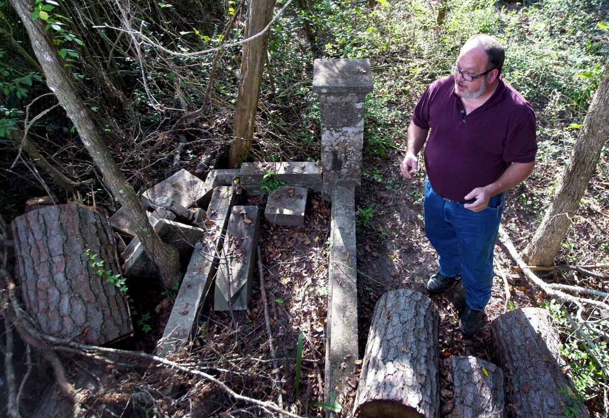 Jon Edens talks about Dora Griffin Armstrong, an African American who lived in the Conroe area in the 1800s at her grave site at Conroe Community Cemetery Oct. 14, 2016, in Conroe.