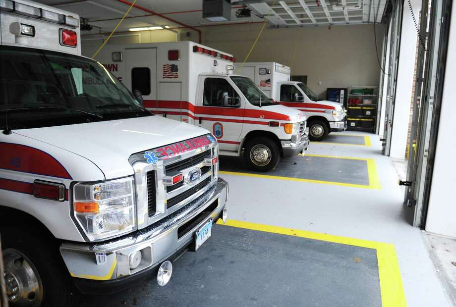 Three ambulances are parked in the garage of the Newtown Ambulance Association's new emergency response center at the Fairfield Hills Campus in Newtown, Conn. Thursday, Oct. 16, 2014. Photo: Tyler Sizemore / Tyler Sizemore / The News-Times