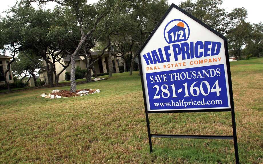 Half Priced Real Estate Company sign, in front of a house in north San Antonio which is listed with them, Wednesday, Aug. 30, 2006. photo Bob Owen Photo: Bob Owen, STAFF / SAN ANTONIO EXPRESS-NEWS / SAN ANTONIO EXPRESS-NEWS