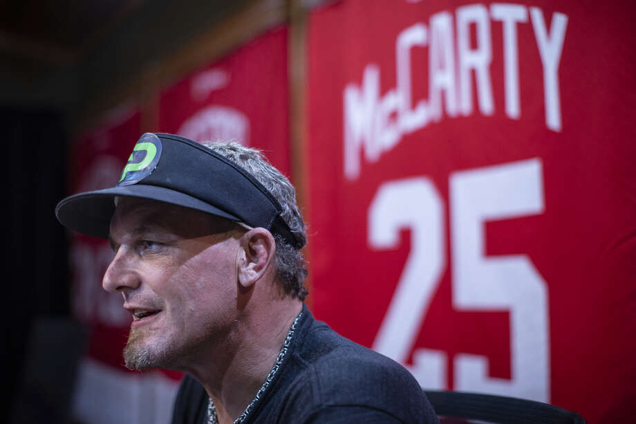 In this Aug. 21 photo, retired Detroit Red Wings hockey star Darren McCarty speaks during an interview at his podcast studio in Franklin. (Junfu Han/Detroit Free Press via AP)