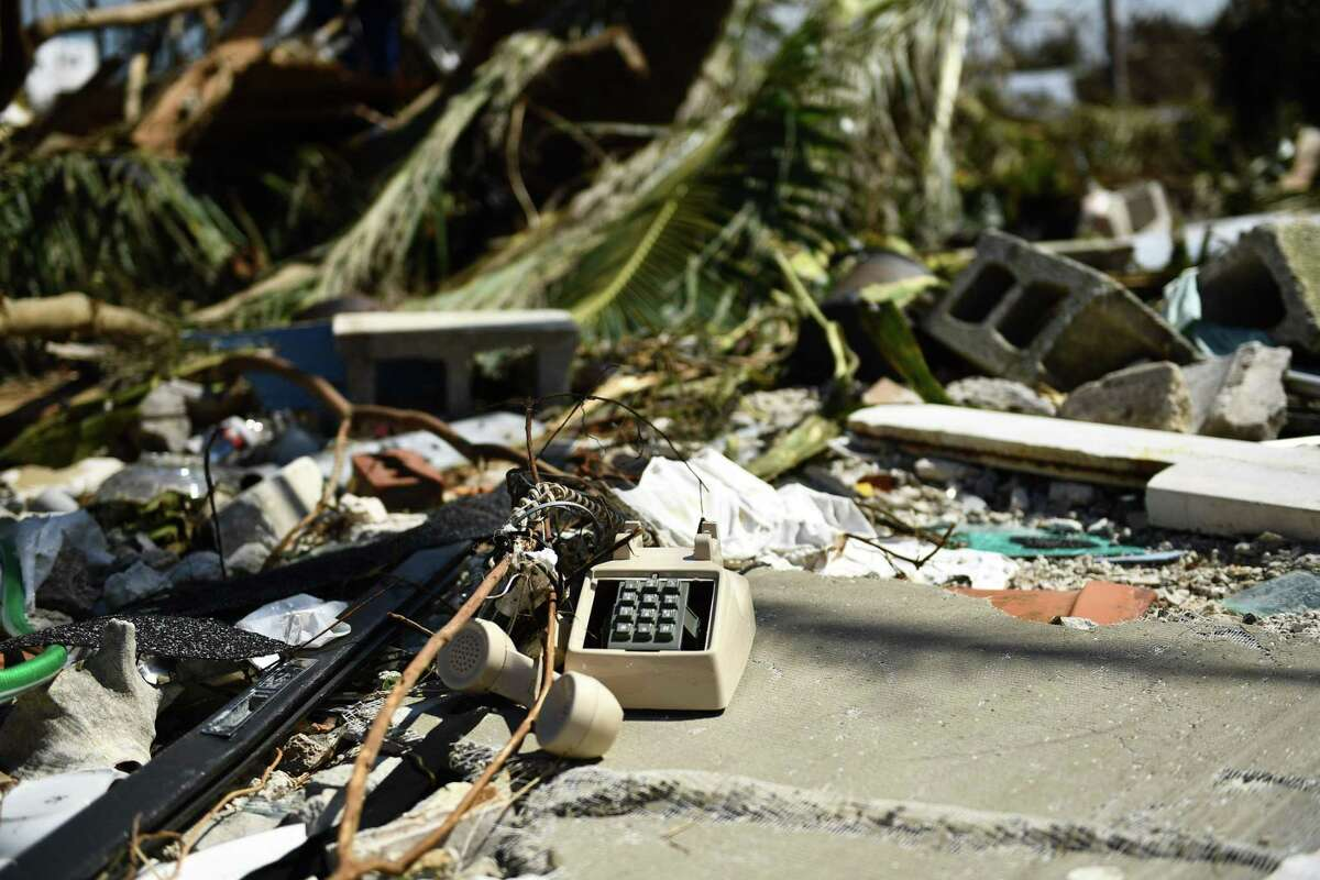 A phone is seen amongst debris after Hurricane Dorian Sept. 5, 2019, in Marsh Harbor, Great Abaco. - Hurricane Dorian lashed the Carolinas with driving rain and fierce winds as it neared the US east coast Thursday after devastating the Bahamas and killing at least 20 people.
