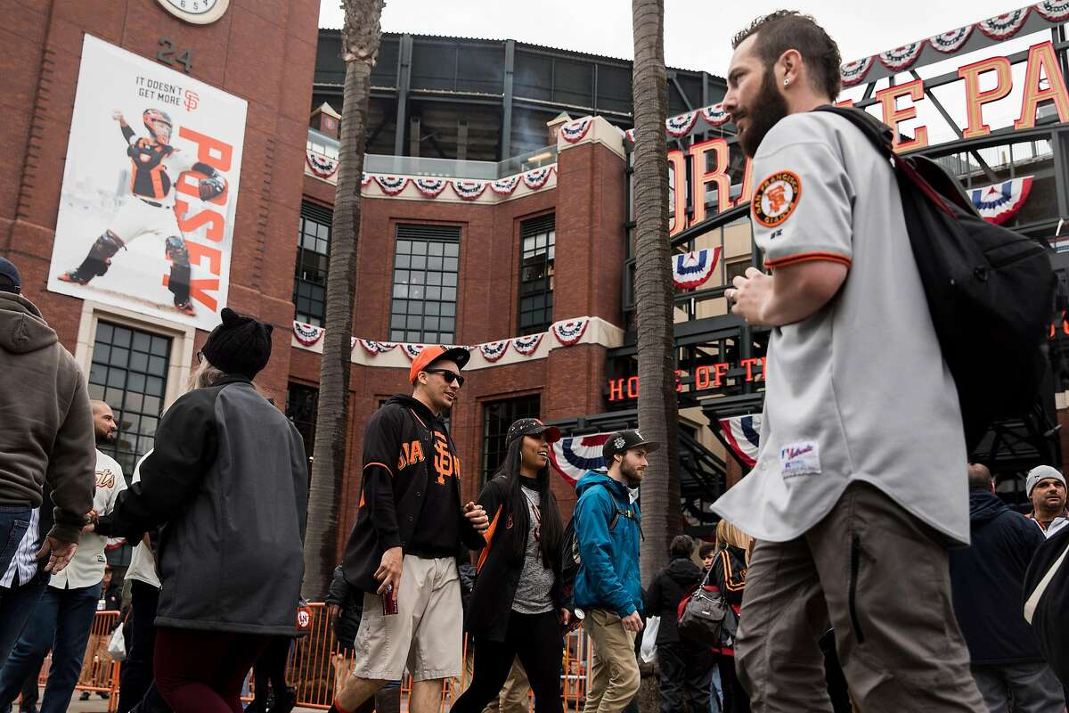 Fans make their way into Oracle Park ahead of the San Francisco Giants opening day game at Oracle Park in San Francisco, Calif. Friday, April 5, 2019.