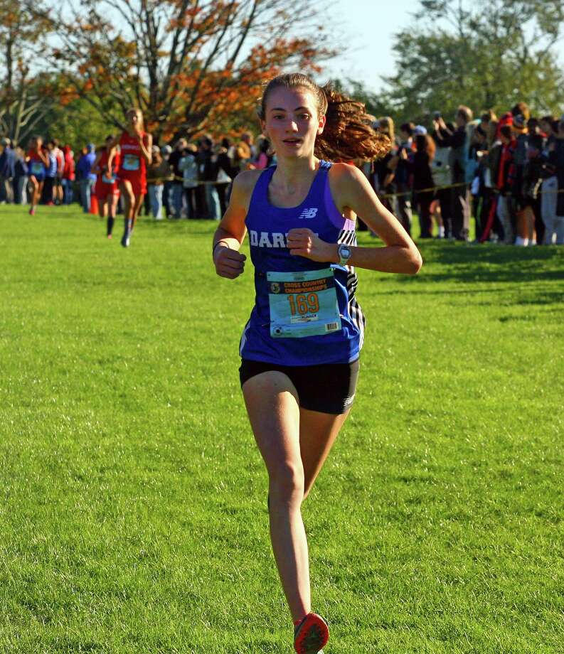 Darien's Mairead Clas reaches the finish line to take sixth place in FCIAC Girls Cross Country Championship action at Waveny Park in New Canaan, Conn., on Thursday Oct. 18, 2018. Photo: Christian Abraham / Hearst Connecticut Media / Connecticut Post