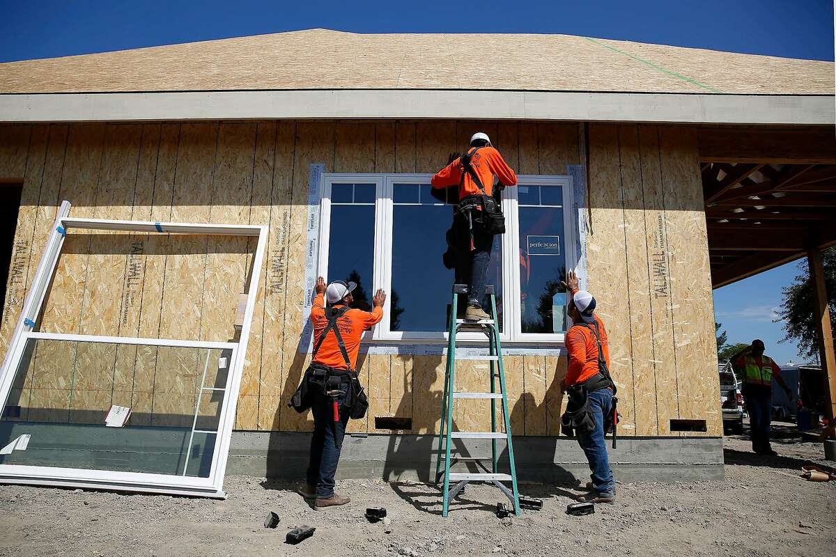 Juan Macias (l to r), Diego Munoz and David Herrera, laborers Wolff Contracting, �work to install a window in the the accessory dwelling unit Michael Wolff (not shown), owner Wolf Contracting, is building for his father on Wednesday, September 4, 2019 in Santa Rosa, CA.