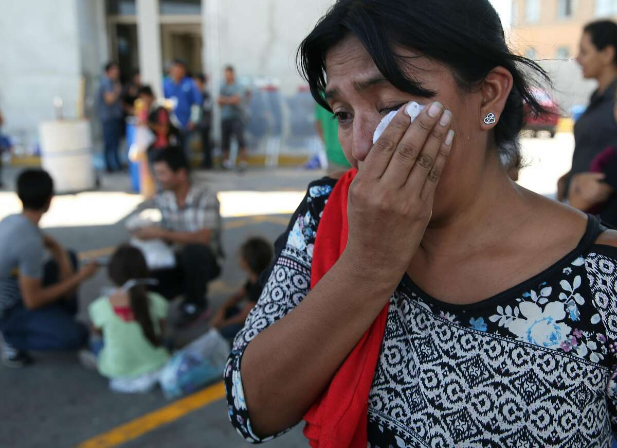 Honduran migrant Sandra Galeano, 38, talks about her ordeal as she shelters by Mexican Immigration offices at International Bridge No. 1 in Nuevo Laredo, Mexico on Thursday, Aug. 15, 2019. Mostly Central American migrants were sheltered by the offices after they crossed into the U.S. seeking asylum but were sent back to Mexico under the Migrant Protection Protocols.
