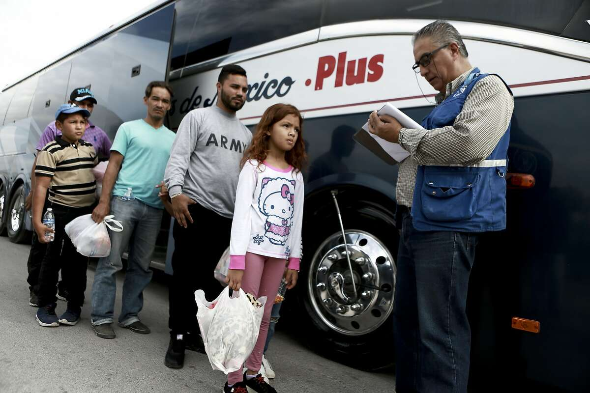 """Central American migrants prepare to board a bus as they voluntarily return to their countries, in Ciudad Juarez, Mexico, Tuesday, July 2, 2019. Dozens of Central Americans who had been returned to the border city of Juarez to await the outcome of their U.S. asylum claims are being bused back to their countries Tuesday by Mexican authorities, a first for that size group of people in the program commonly known as ?'remain in Mexico.?"""" (AP Photo/Christian Chavez)"""