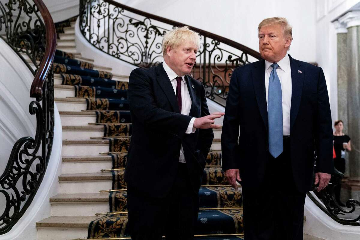 British Prime Minister Boris Johnson, joined by President Donald Trump, speaks before a working breakfast at the G7 Summit in Biarritz, France, Aug. 25, 2019.