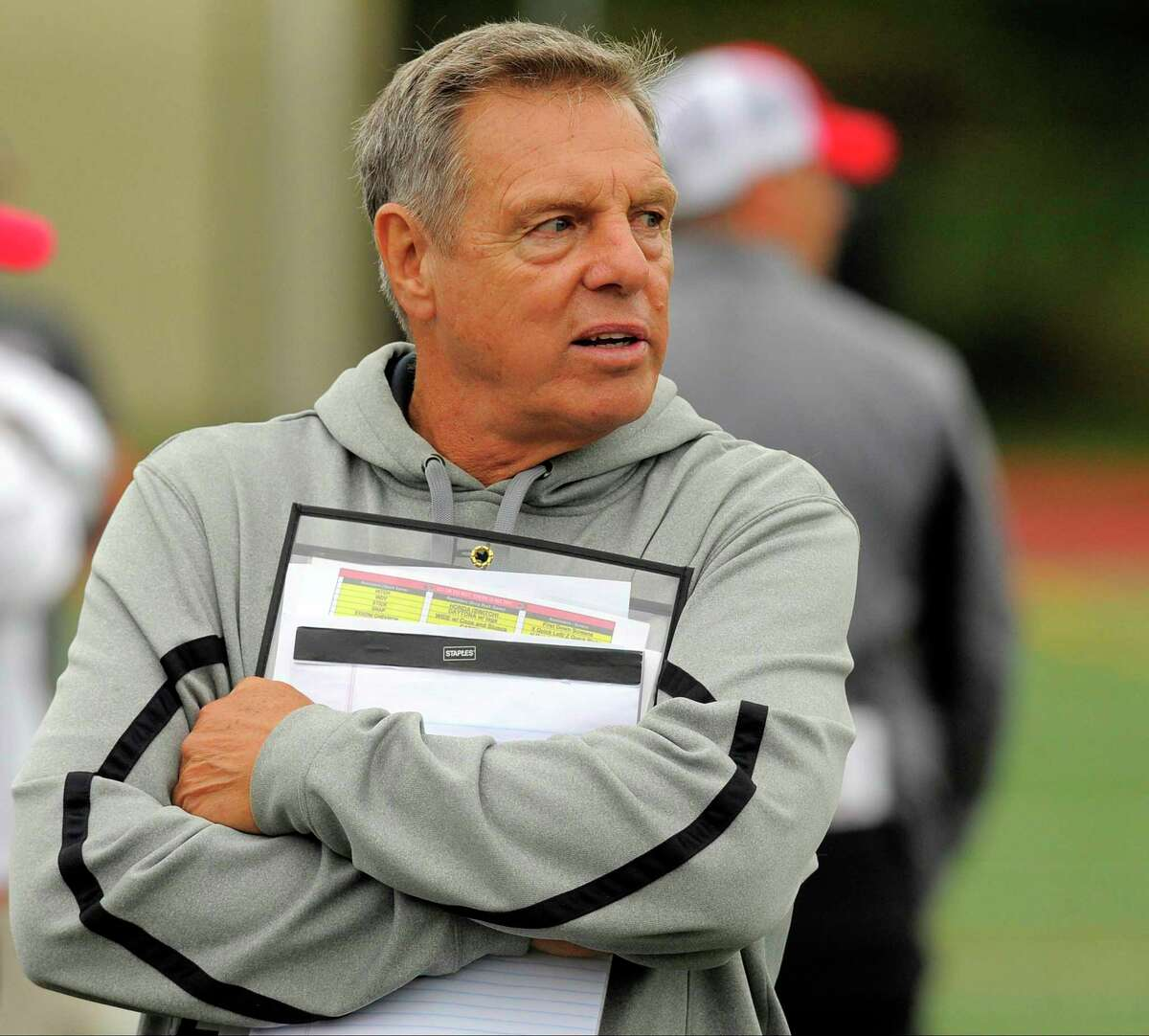 New Canaan coach Lou Marinelli follows the action of a football game at Westhill High School's J. Walter Kennedy Stadium in Stamford, Conn. on Saturday, Oct. 1, 2016. New Canaan defeated Westhill 35-7.