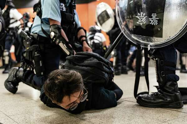 Chinese President Xi Jinping's hard line toward Hong Kong, above, has fueled concerns in Taiwan that it may soon be the target of Chinese might. And that could prompt American politicians to try to help Taiwan in ways that increase the risk of triggering a crisis.