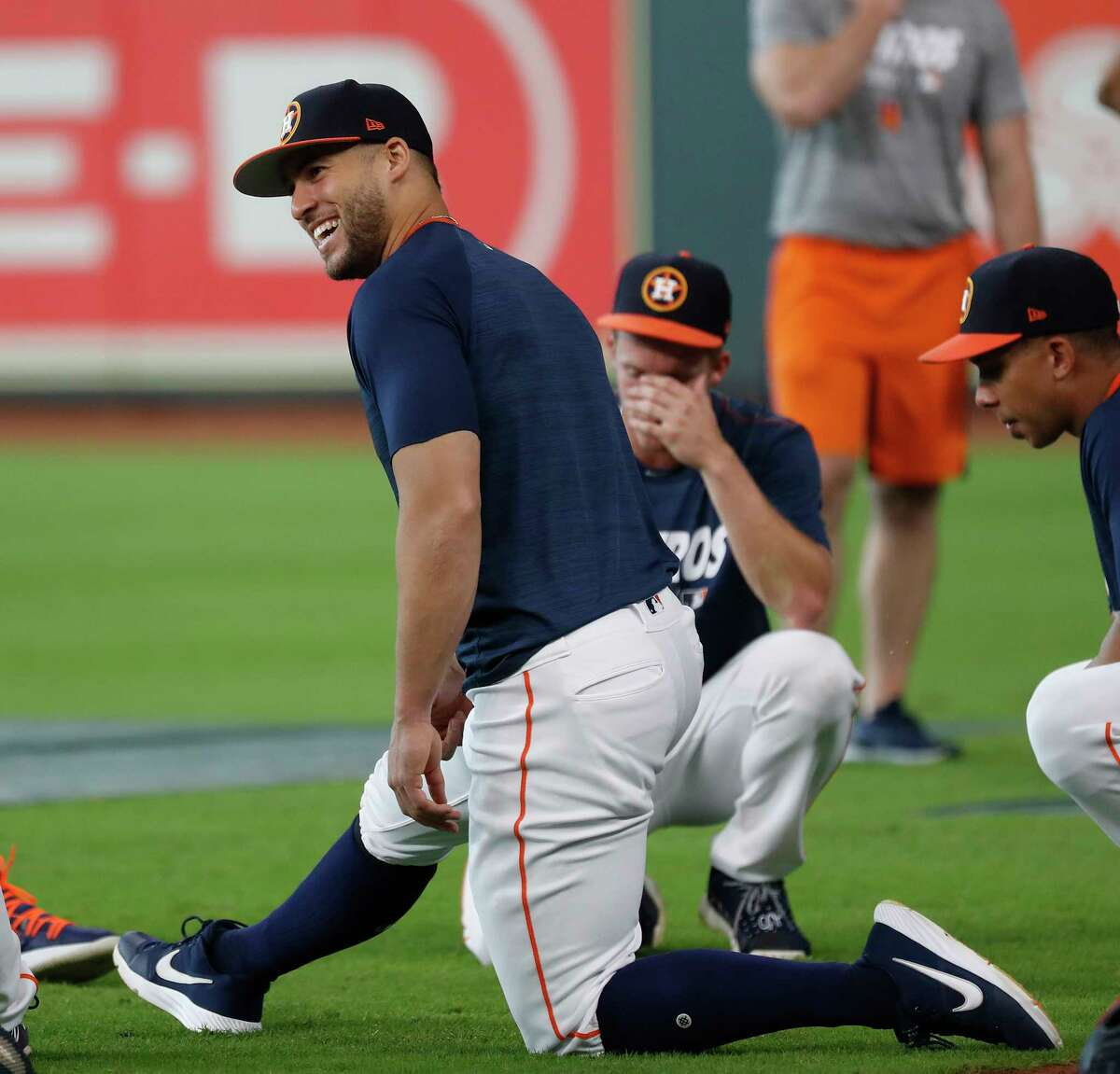 Houston Astros George Springer laughs as he stretches during batting practice before the start of an MLB game at Minute Maid Park, Thursday, September 5, 2019, in Houston.