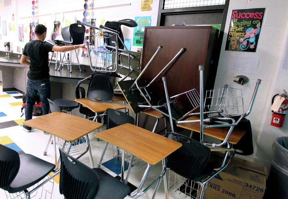 A high school student takes part in a lockdown drill in Corpus Christi in 2013. With school in session, a reader wonders how students can be assured they are safe. Photo: Associated Press File Photo / Corpus Christi Caller-Times