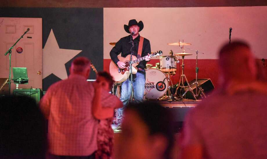 Robert Bumstead, an up-and-coming country musician, plays some songs at the Texas Honky Tonk in Silsbee Saturday night. A native of Kountz, who lives in Groves, Bumstead got the music bug while growing up in Nashville. Photo taken on Saturday. Ryan Welch/The Enterprise Photo: Ryan Welch / Ryan Welch/The Enterprise / ©Ryan Welch