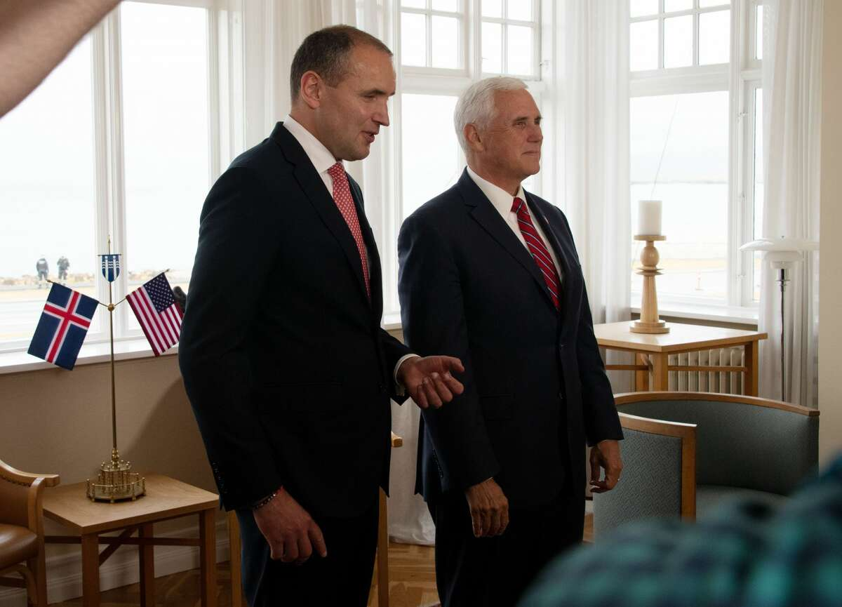 US Vice President Mike Pence (R) meets Iceland's President Gudni Th Johannesson (L) at Hofdi House in Reykjavik on September 4, 2019. - In Iceland, Pence is expected to bring up incursions into the Arctic Circle by China and Russia amid growing tensions in the polar region over melting ice and access to minerals, a White House official has said.