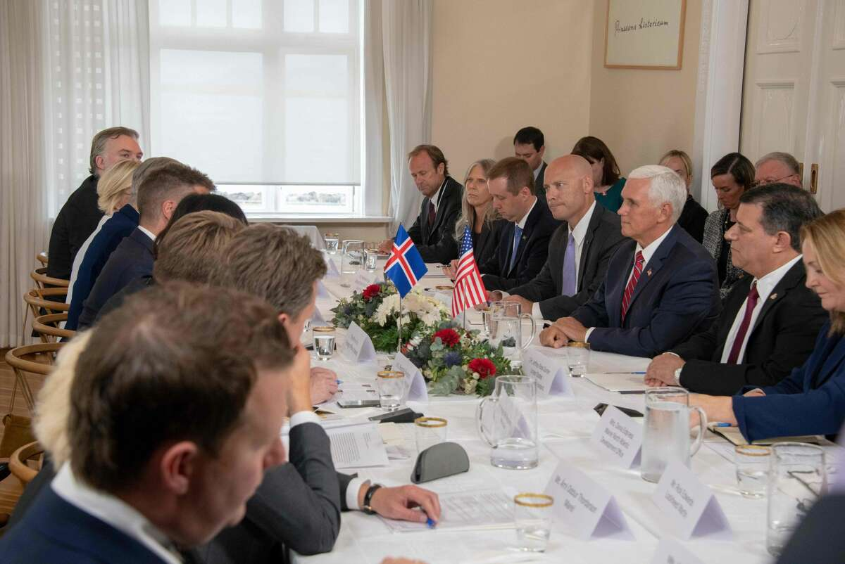 US Vice President Mike Pence (C) attends a roundtable discussion on US-Iceland trade and investment relations with the Minister for Foreign Affairs of Iceland at Hofdi House in Reykjavik on September 4, 2019. - In Iceland, Pence is expected to bring up incursions into the Arctic Circle by China and Russia amid growing tensions in the polar region over melting ice and access to minerals, a White House official has said.