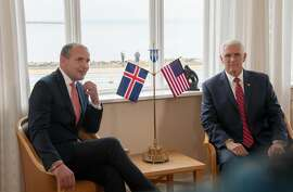 US Vice President Mike Pence (R) meets Iceland's President Gudni Th Johannesson (L) at Hofdi House in Reykjavik on September 4, 2019. - In Iceland, Pence is expected to bring up incursions into the Arctic Circle by China and Russia amid growing tensions in the polar region over melting ice and access to minerals, a White House official has said. (Photo by Jeremie RICHARD / AFP)        (Photo credit should read JEREMIE RICHARD/AFP/Getty Images)