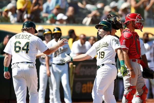 A's score seven in the seventh for comeback win over Angels