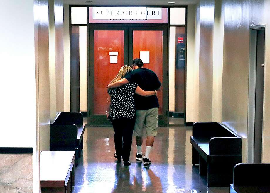 Mary and Alberto Vega, mother and brother of Ghost Ship fire victim Alex Vega, embrace in the hallway after the verdict. Photo: Scott Strazzante / The Chronicle