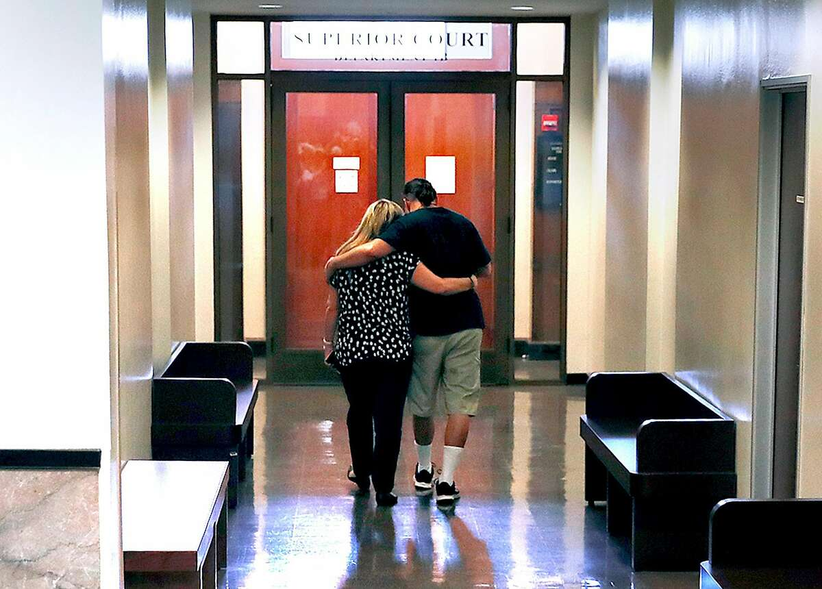 Mary and Alberto Vega, mother and brother of Ghost Ship fire victim Alex Vega, is embraced as he walks down hallway after the verdict in the Ghost Ship warehouse fire trial at the Alameda County Superior Court in Oakland, Calif., on Thursday, September 5, 2019.